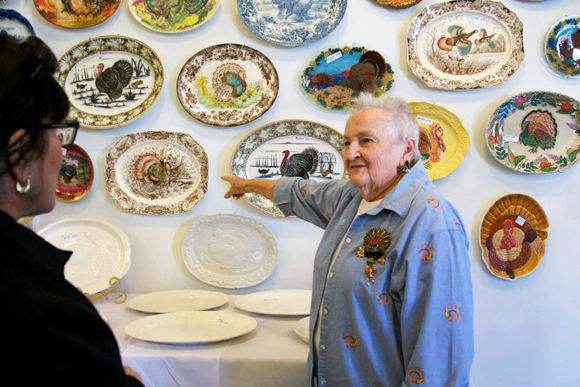 Helen Gleason with her collection, at the Turkey Platter Museum.