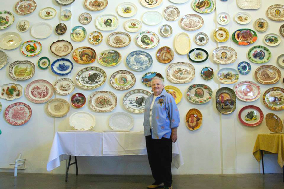 Helen Gleason with her collection, at the Turkey Platter Museum. Photo by Anne Marie Rousseau.