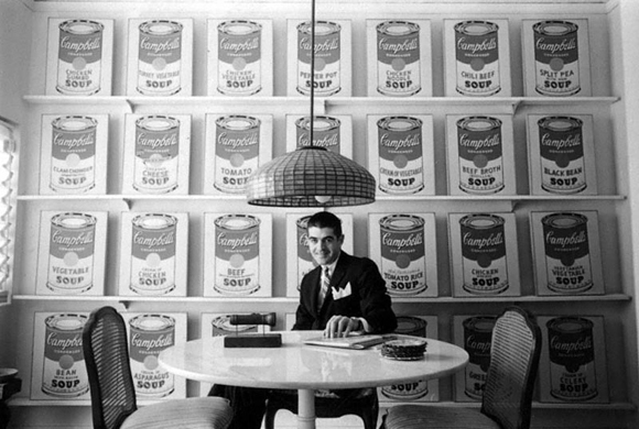 Irving Blum with Andy Warhol's Campbell's Soup Cans at the Ferus Gallery in Los Angeles, 1962. Photo by William Claxton.