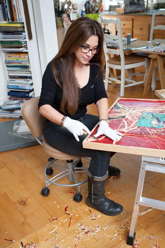 Fatemeh Burnes working in her studio.