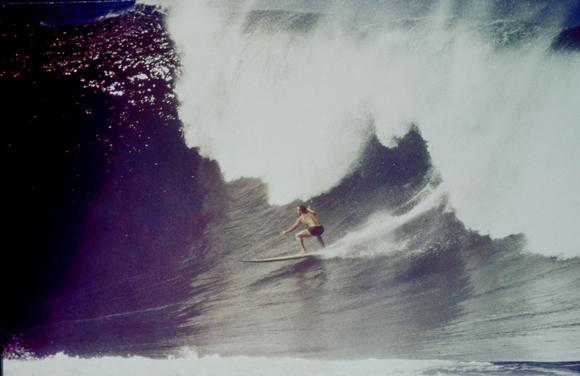 Legendary big-wave surfer BuzzyTrent navigates a break. | Bud Browne Film Archives