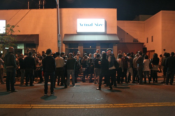 "Crowd at ""Please Remember Everything,"" a late night exhibition that included film, video, and performance. 