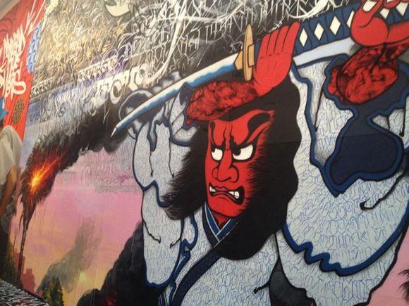 "This mural includes work by Alex ""Defer"" Kizu, Big Sleeps, Cryptik, Gajin Fujita, Jose ""Prime"" Reza, Kopey, Patrick Martinez and Saber. | Photo: Liz Ohanesian"