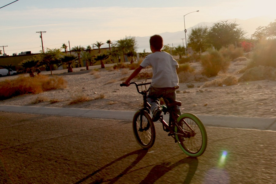 A bicyclist riding to the next art site  | Photo: Drew Tewksbury