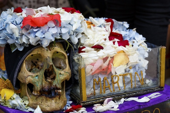 Skull with flowers at Fiesta de las Ã'atitas in LaPaz, Bolivia | Photo by Paul Koudounaris