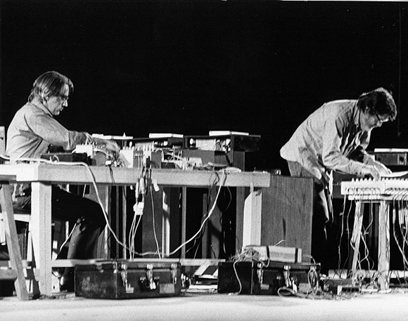 Shiraz Art Festival: David Tudor (left) and John Cage performing at the 1971 festival. | Photo: Courtesy Cunningham Dance Foundation archive. Photo from Wikipedia Commons.