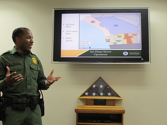 Agent Stricklin with map of the San Diego Border Patrol sector. | Photo: Jena Lee.