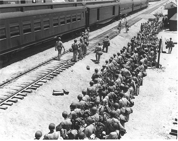 Soldiers disembark at the Freda railroad siding, off what is now Highway 62.  Established railroad lines made the Desert Training Center ideal for transporting troops and equipment. U.S. Army photograph | Courtesy of the General Patton Memorial Museum.