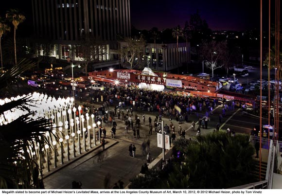 Megalith slated to become part of Michael Heizer's 'Levitated Mass,' arrives at Los Angeles County Museum of Art, March 10, 2012. © 2012 Michael Heizer, photo by Tom Vinetz. Chris Burden's 'Urban Light' is in the foreground to the lower left.