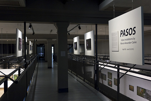 Installation view of <em>PASOS: Video Installations by Marsia Alexander-Clarke</em> on the walkway or second stage of the installation. | Photo: Courtesy of UCR/California Museum of Photography.