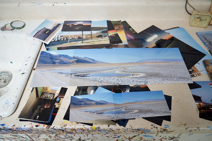Photographic views of the Owens Dry Lakebed , Lone Pine California,  spread out as Patricia Chidlaw creates her composition for a painting. | Photo: Osceola Refetoff