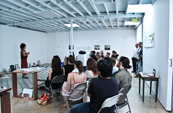 """Patricia Fernández, """"Points of Departure (between Spain and France),"""" performative lecture, May 2, 2014. Artist Lab Residency at 18th Street Arts Center, April 14-June 27, 2014. Photo by Erica Rodriguez. Courtesy of 18th Street Arts Center."""