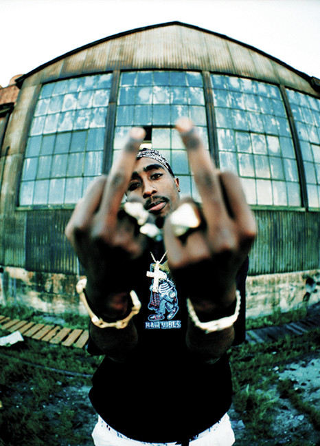 Many of Miller's photo shoots with rappers happened at the beginning of their career. With Tupac Shakur however, the rapper was nearing the height of his fame; he was anything but a newcomer. Tupac Shakur, 1994 | Photo by Michael Miller