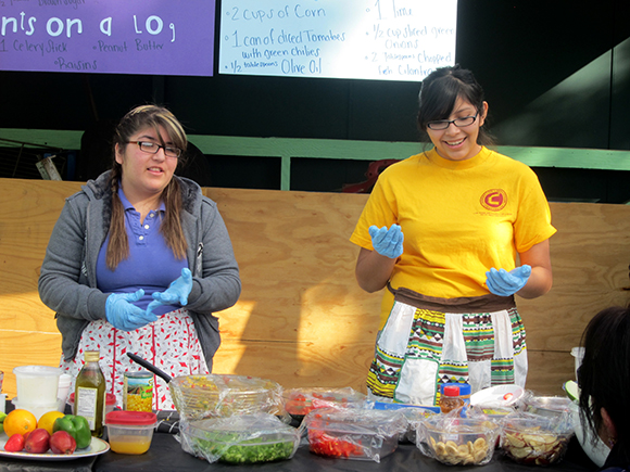Along with ELARA classmate Liliana Guizer Serrano, Shirley leading a cooking demo at Yash La Casa Market, January 2012.