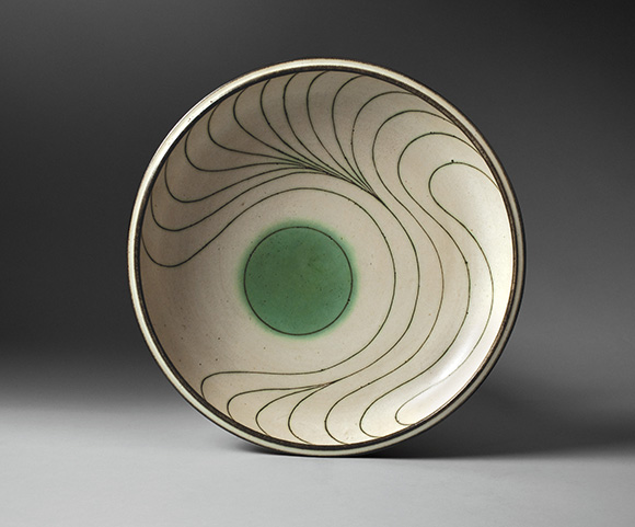"Platter, 1975. Glazed, cone 5 stoneware with mishima lines, 2 1/2"" x 15 1/2"" dia. Collection of Catherine McIntosh. 