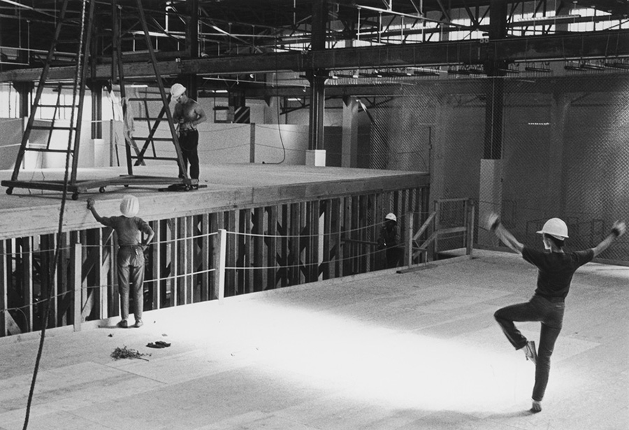 Worker dancing on stage. | Photo: Grant Mudford.