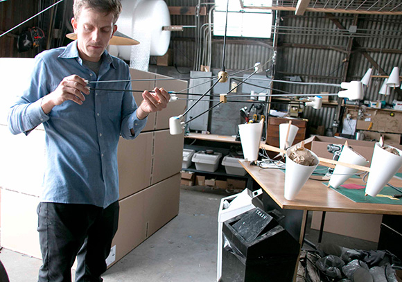The designer and his pieces in progress. | Photo: Carren Jao.