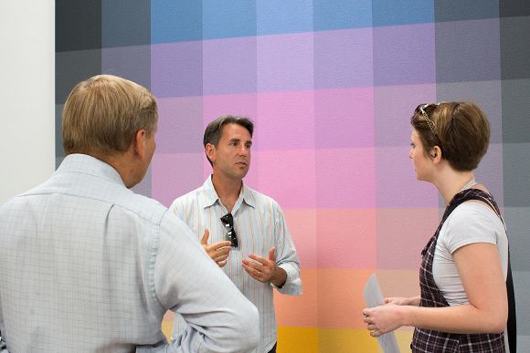 "Brian Goeltzenleuchter speaking with patrons at his 2014 exhibition, ""Sillage,"" Santa Monica Museum of Art."