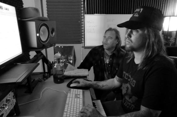 Musician and artist Vincent Bernardy works with Travis Warren. | Photo: Catherine J. Trujillo.