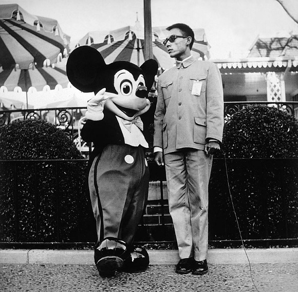 Tseng Kwong Chi, <em>Disneyland, CA</em>, 1979, From the series 'Expeditionary Self-Portrait'. Gelatin silver print. Santa Barbara Museum of Art, Museum purchase with funds provided by PhotoFutures.