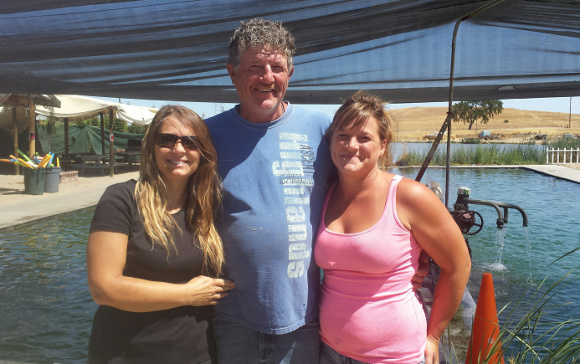 Norm Franklin, center, is the third generation of Franklins to run the family hot springs with his wife, Cindy at left and daughter, Lacey, right. | Photo: Yvonne Willis.