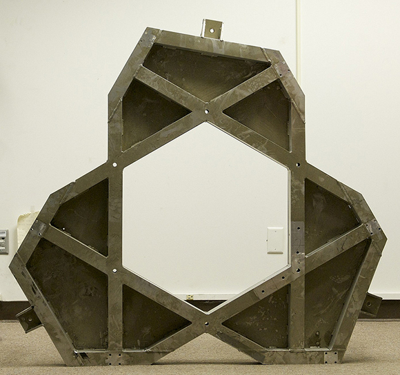 The original Mars Rover base plate, which Goods repurposed into a base for a glass table. | Courtesy of Dan Goods.