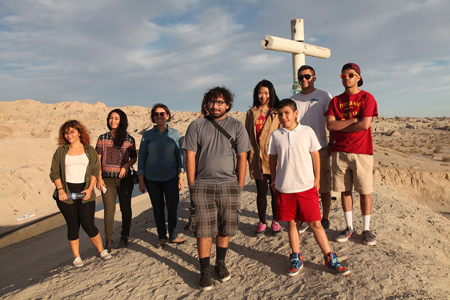 Students and residents assemble on a hilltop | Photo: Drew Tewksbury