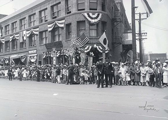 """Street Parade of Little Tokyo, 1932 Olympics"" by Toyo Miyatake, 1932, Courtesy of Alan Miyatake of Toyo Miyatake Studio."