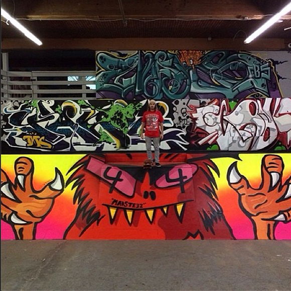 Madsteez standing on his new piece at Hurley Skate Park. Also pictured: new work by Yanoe, Craola, and Sramars.