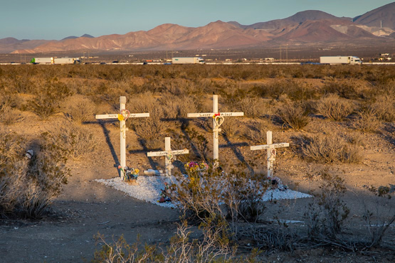 The McStay family memorial site located northwest of Victorville, CA. Traffic on the I-15 can be seen in the distance. | Photo: Kim Stringfellow.
