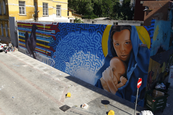 Completed mural in Istanbul by Levi Ponce and Kristy Sandoval. | Photo: Mehmet Naci Demirkol.