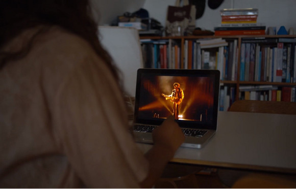 """Nicole Miller watching """"Anthony."""" The video is part of larger installation """"The Borrowers."""""""