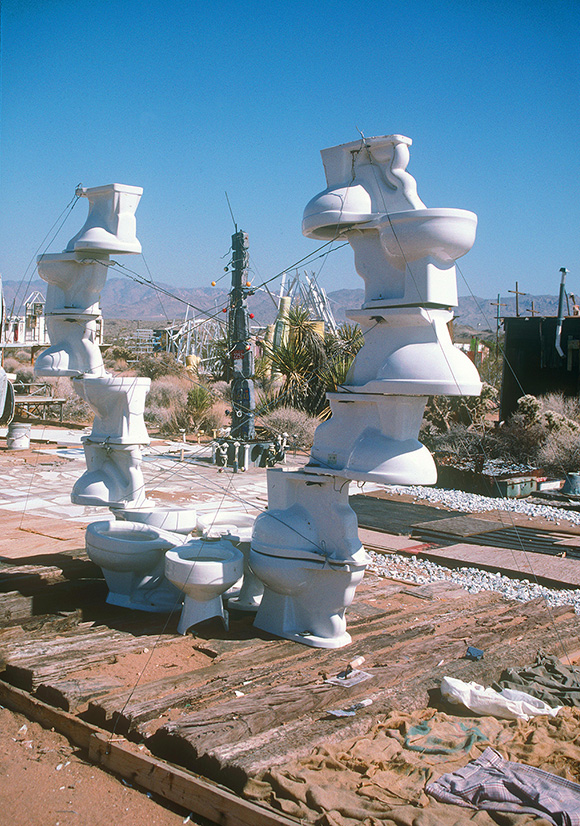 "Noah Purifoy, ""Toilet Bowl Sculpture,"" 1996. 120 x 144 x 19 in. Noah Purifoy Foundation, Joshua Tree. © Noah Purifoy Foundation. Photo courtesy Noah Purifoy Foundation."