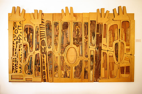 """Noah Purifoy, """"Black, Brown and Beige (After Duke Ellington),"""" 1989. 68 × 113 in. Sue A. Welsh Collection. © Noah Purifoy Foundation. Photo courtesy Noah Purifoy Foundation, by Seamus O'Dubslaine."""
