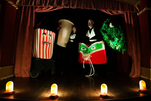 Jasmine Orpilla (left, as The Vital Organ) and Philip Littell (The Star, right) cavort with puppets (l to r) Donkey, LoPhat, Starvation, and Salad Bar. | Photo: Marianne Williams