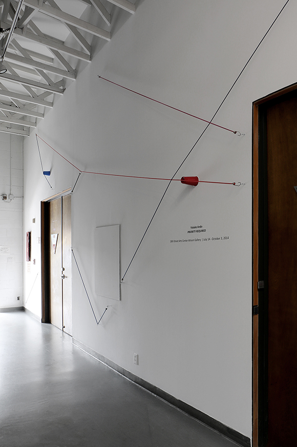 """""""Picnic,"""" 2014. Bungee cords, plastic cups, and hardware. Installed dimensions variable. """"Priority Required,"""" installation at 18th Street Arts Center Atrium Gallery, 2014. 