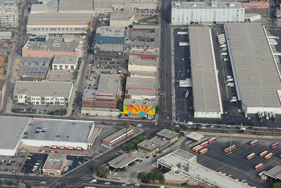 Mural from the air, showing how it becomes welcome to the Arts District.  The city also designates the corner as the Downtown Industrial District.   Photo: MOCA.