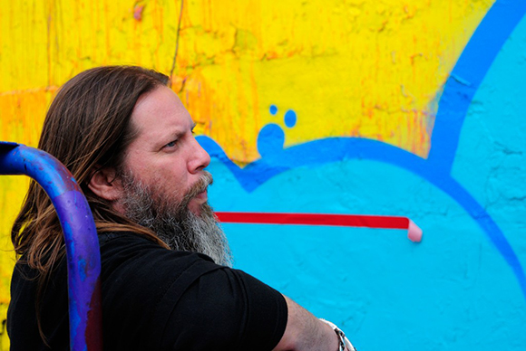 RISK checking out the colors of his mural for Skid Row Housing Trust. | Photo: MOCA.