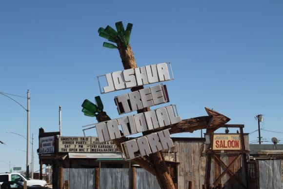 Sign for Joshua Tree National Park in front of the saloon.