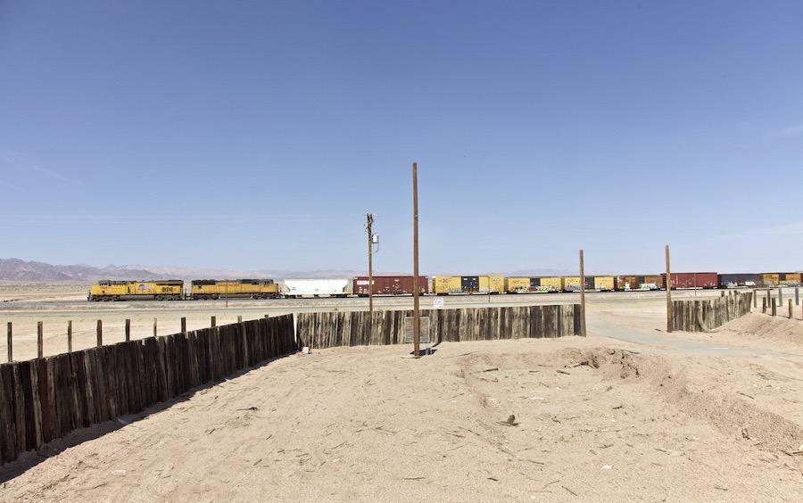 """Desert Ruin with Train Passing."" Salton Sea, CA. 2014. | Photo: Osceola Refetoff."