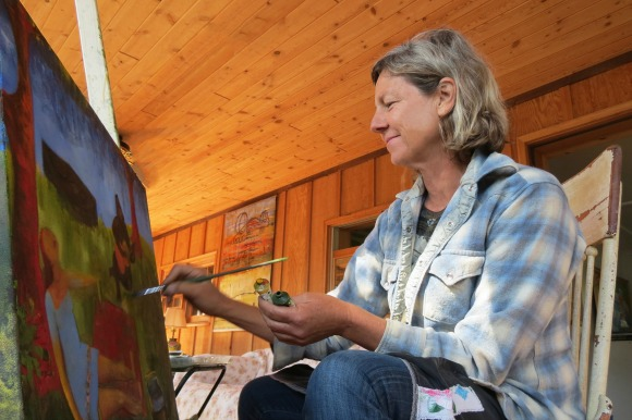 Artist Suzi Bliss in her lakeside studio. The remote cabin overlooks Lake Nacimiento in rural San Luis Obispo County. | Photo: Catherine J. Trujillo.