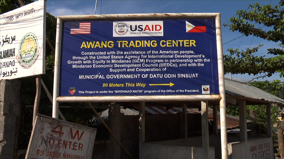 US Aid Sign, Cotabato City | Photo: Courtesy of Sara Schnadt.<br />