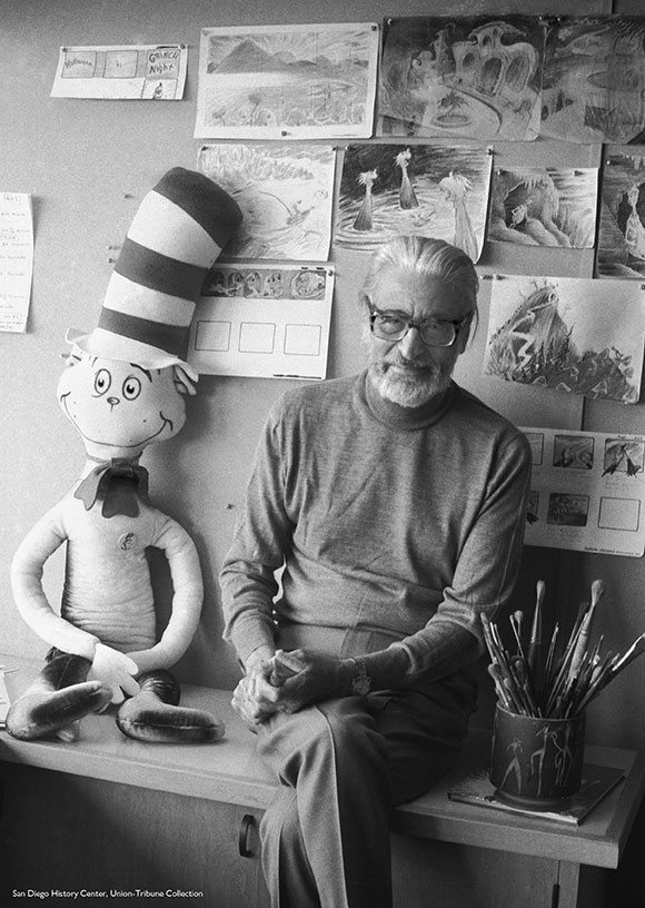 Ted Geisel with drawings, 1976 | San Diego History Center, Union-Tribune Collection