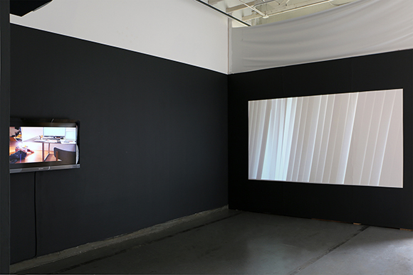 """""""Orientation"""" and """"Rain,"""" both 2014. Digital videos. """"Priority Required,"""" installation at 18th Street Arts Center Atrium Gallery, 2014. 