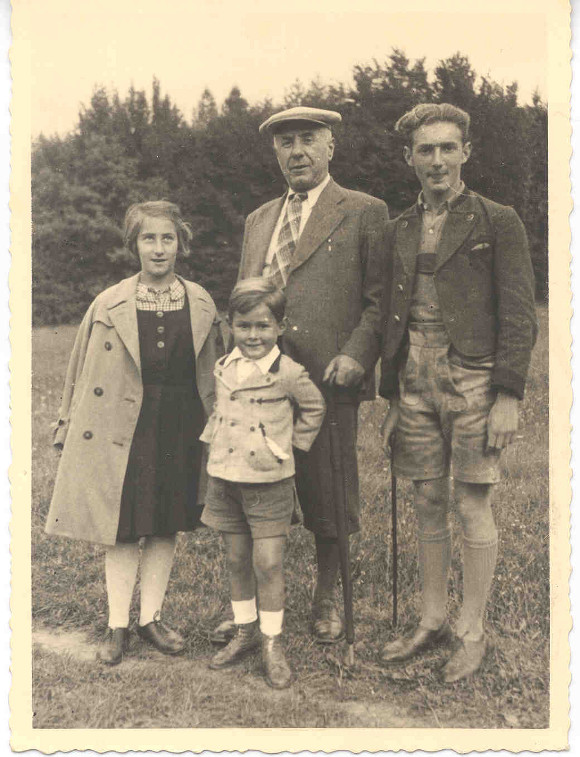 Walter Arlen hiking in the woods near Sauerbrunn, Austria, in 1935. From left, sister Edith Aptowitzer (changed later to Arlen); cousin Peter Silberstein; grandfather Leopold Dichter, founder of Warenhaus Dichter in Vienna; Walter (Aptowitzer) Arlen.