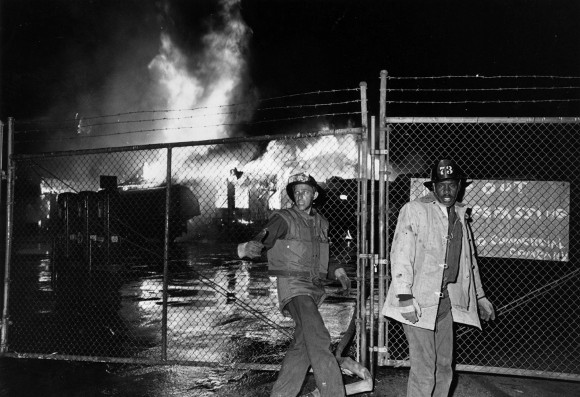 Fire-fighters in front of a blazing building during the Watts Riots in Los Angeles, California, 11th-15th August 1965. | (Photo by Harry Benson/Express/Getty Images).