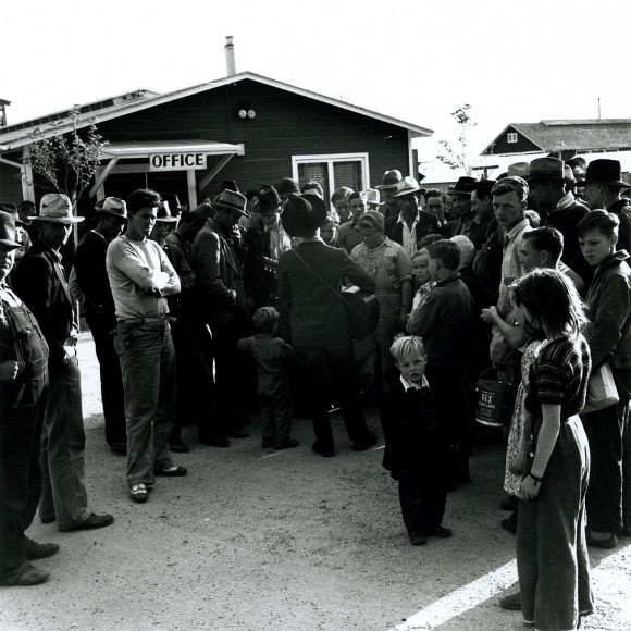 """Woody Guthrie singing at Shafter Labor Camp, 1941. 