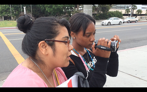 Workshop participants filming on streets | Courtesy of Moonlight Media