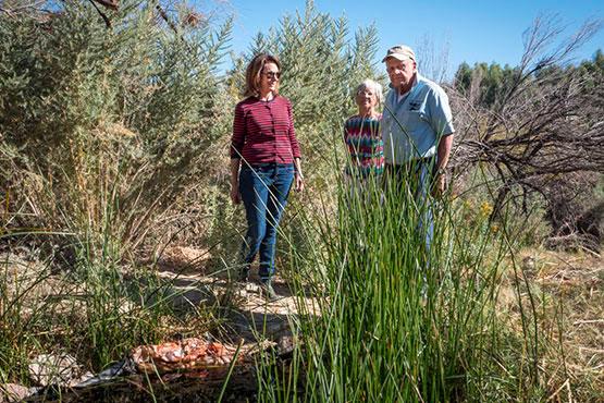 Susan Sorrells and Phil Pister with companion at the Shoshone pupfish refugium, Shoshone, CA. | Photo: Kim Stringfellow