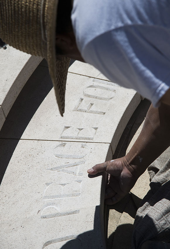 Nacacio Aparicio works on the new 'Armenian Genocide Memorial' in Pasadena, California on April 17, 2015, before the official unveiling and dedication ceremony the following day. | ROBYN BECK/AFP/Getty Images